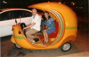 Joe McGowan and his wife Babette Andre in a coconut-shaped Coco taxi in Havana in 2012.