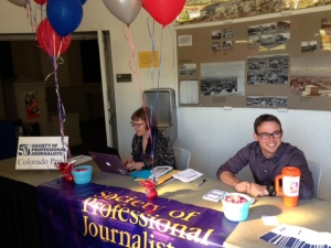 SPJ Colorado Pro board secretary Sandra Fish and SPJ Auraria Chapter president Aaron Graff man the registration table April 24 at the Region 9 Conference on the Auraria campus in Denver.