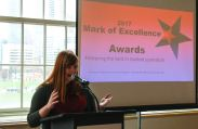 Rachael Worthington prepares to introduce Mark of Excellence winners.